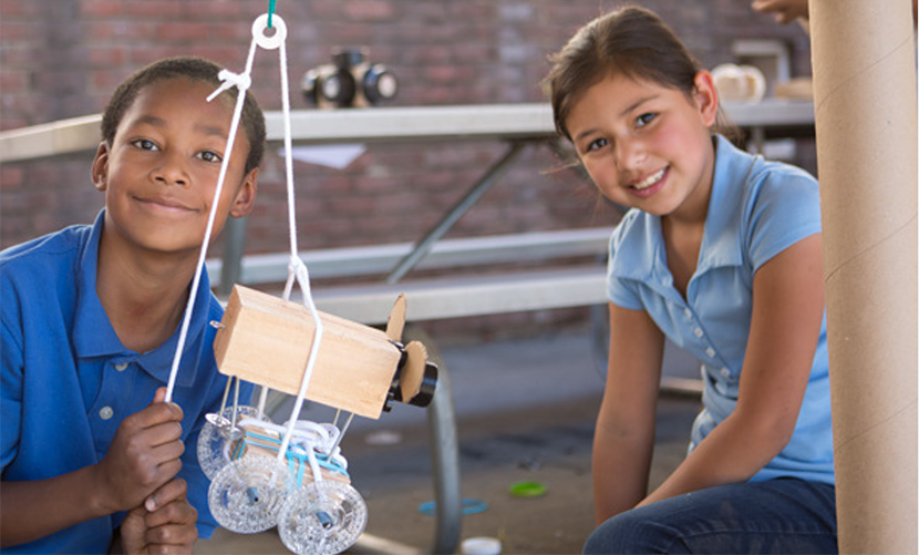 Photo: Children Holding up a STEM project