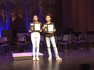 Image of two students presenting their awards at the music festival