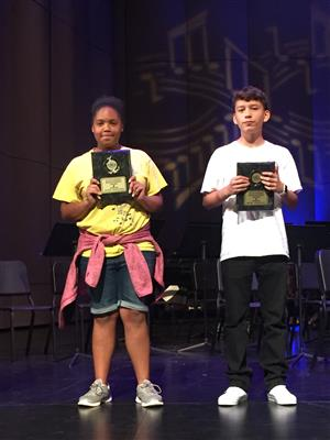 Image of two students showing their awards at the music festival