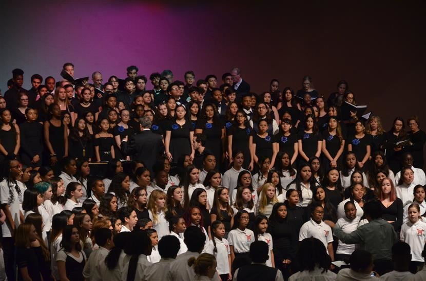 A photo of a large choir of students singing